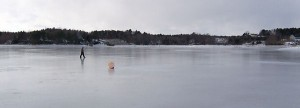 Walking on the ice past a mooring buoy, Jan. 25