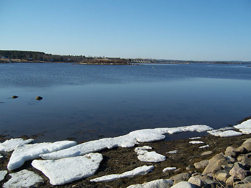 The ice that yesterday filled the cove has floated out to sea.