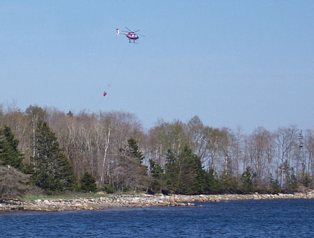 Water-bombing helicopter over Oak Island.