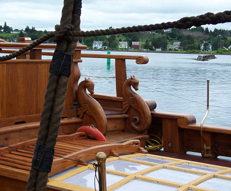 Larinda's deck, with graceful carvings, is being restored.