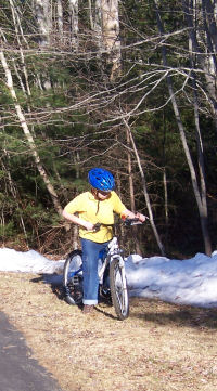 Kid on bike with snow