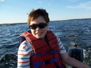Boy running outboard motor