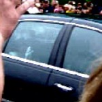 Queen Elizabeth II driving by