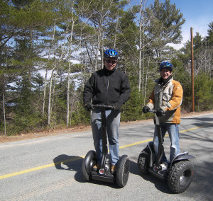 Wynand and Max segwaying their way down the road from the causeway to Oak Island